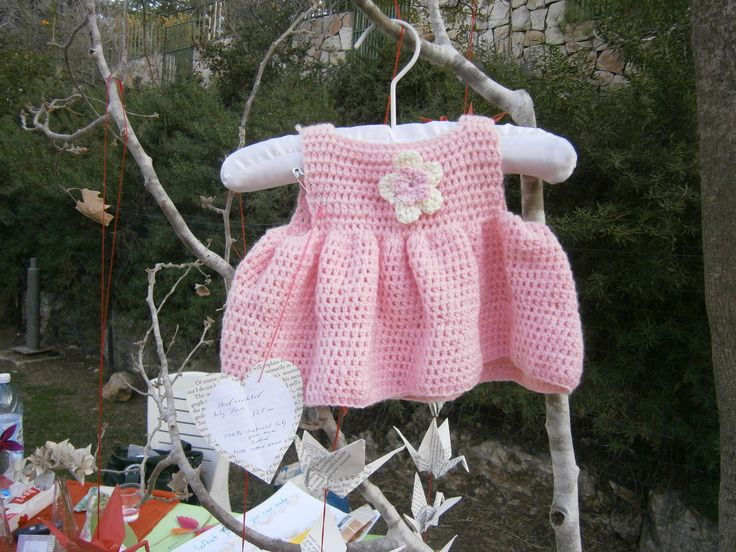 This adorable baby dress is filet crocheted from special lambswool brought specially from Scotland in a light baby weight. It was crocheted and designed by Sarah age 14 and sold immediately at our local craft fair. Can be made to order.