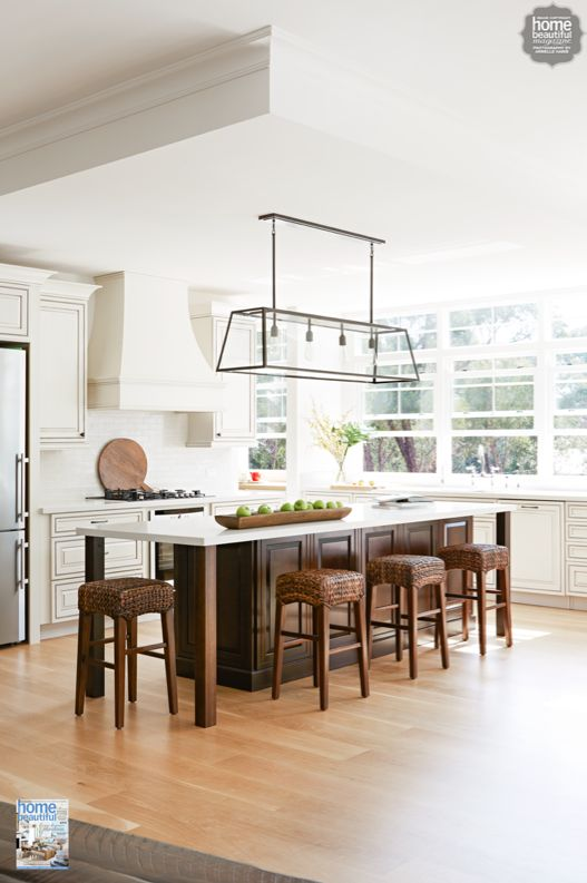 A lovely Melbourne kitchen with a striking iron & glass pendant light and Amish-made cabinetry.