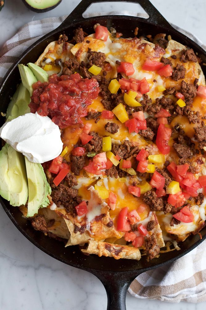 Skillet Nachos! Loaded with seasoned lean ground beef, cheddar cheese, mozzarella cheese, tomatoes, avocados, sour cream and salsa. You need this at your Super Bowl Party! My family and I love nachos. Like, love like them. My kids especially love the creamy nacho cheese sauce that they have at the movie theater. I don't even...Read More »