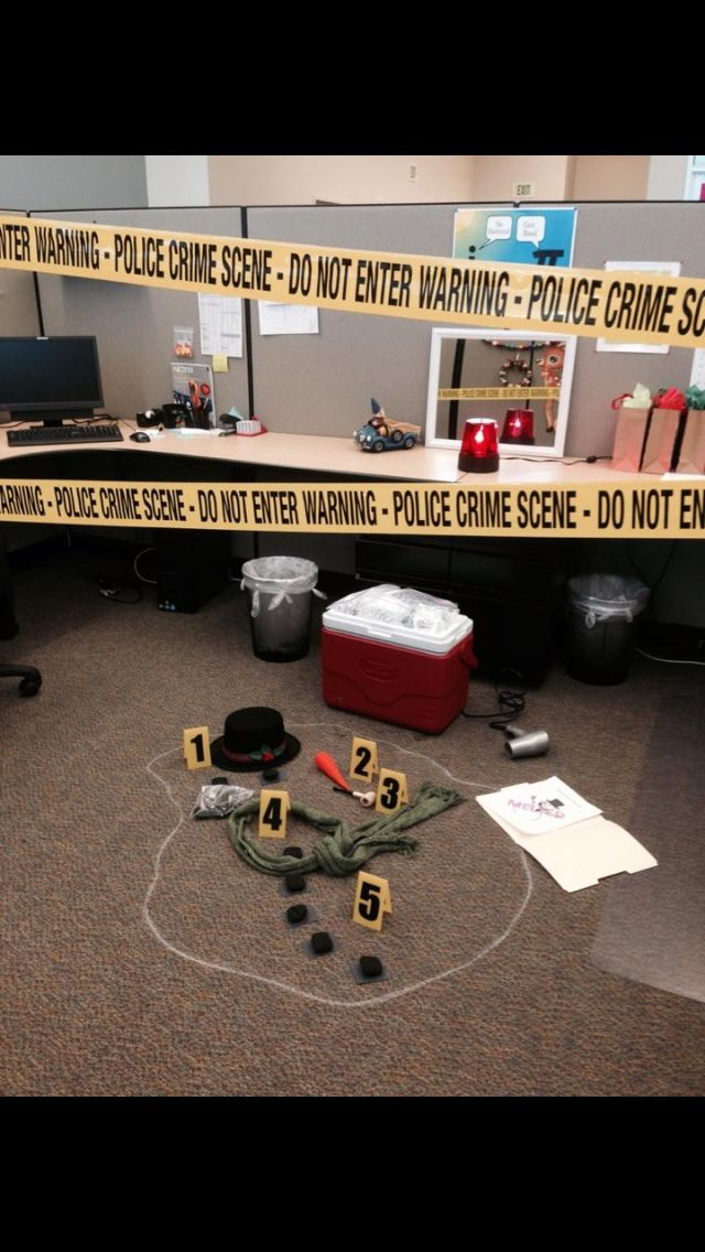 "Snowman crime scene for cubicle decorating contest. Complete with evidence markers, bagged ""evidence"" (water), scarf, top hat, corncob pipe, police light, and crime scene tape. Make a person of interest flyer with a photo of another holiday character."