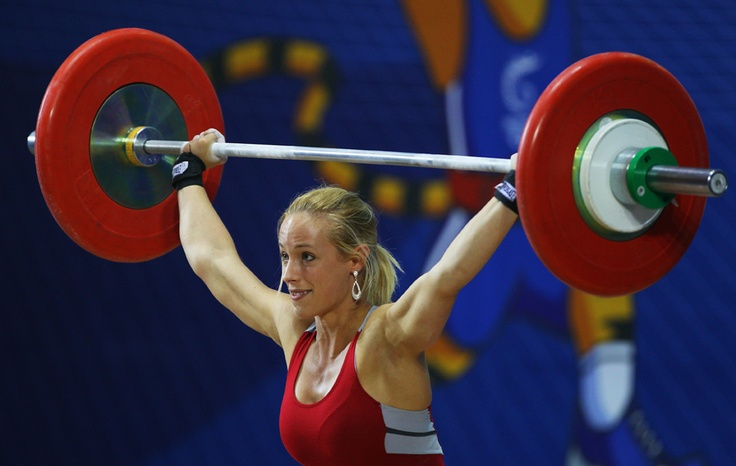 Olympic Weightlifting.  The women smile, the men grimace.