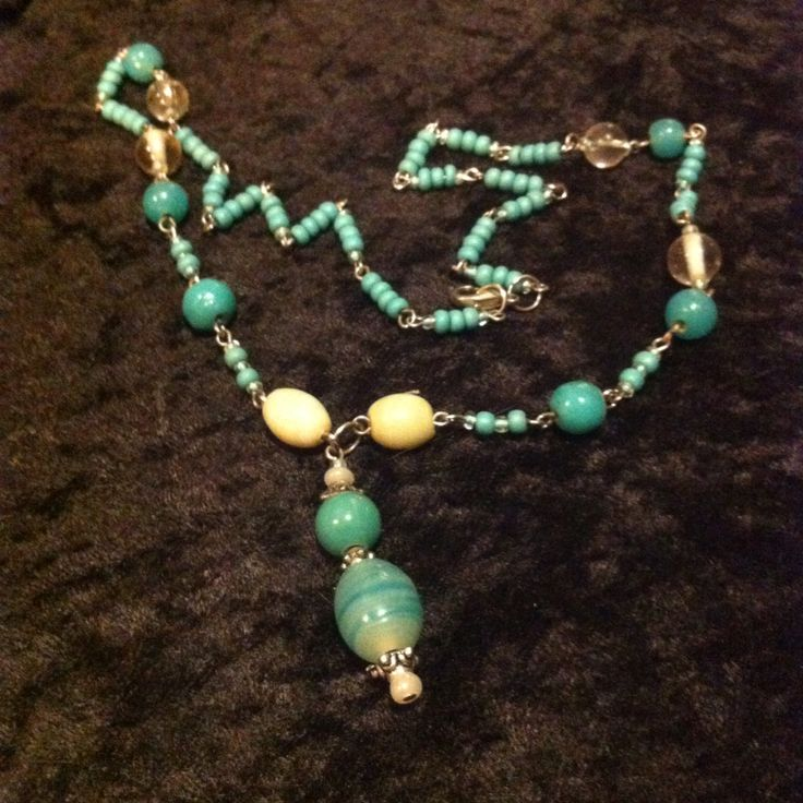 Turquoise & cream pendent necklace with an aboriginal free. Glass & ceramic
