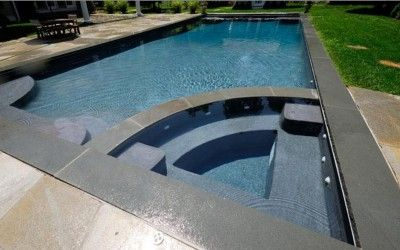 #Bluestone Pool Coping border, with quartz crazy paving used for the pool paving
