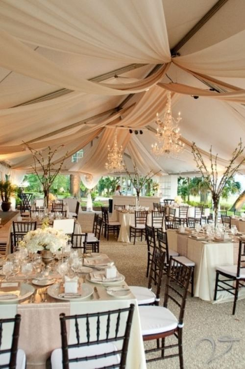 Great mixture of elegant and chic. From tree branches to chair color and hanging chandeliers. Plus those drapes-Yes!
