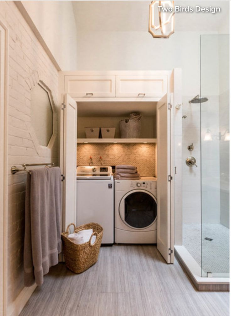 Hidden laundry room in a bathroom. Just use the washer as a dirty clothes hamper!