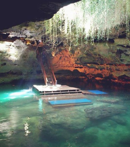 Walk down these steps and take a dip into a top secret pre-historic pool.  One of the world's most epic natural dive spots, right here in the USA.