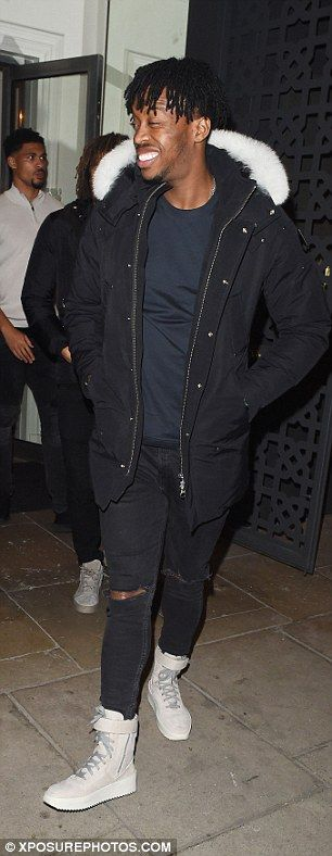 Youngster Nathaniel Chalobah flashes a smile as he leaves the restaurant