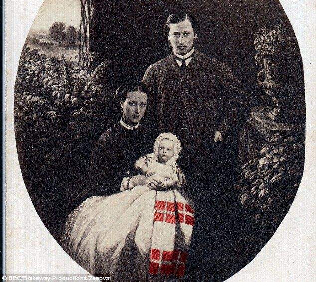 Queen Alexandra, pictured with Edward VII and their son Albert, hated Germany after its conquest of parts of her native Denmark. Alexandra found subtle ways to show her true feelings such as in this traditional christening gown that had tiny replicas of the flag of Denmark woven through it.