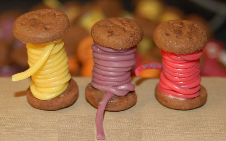 Cotton reels with chocolate biscuits and sweets http://www.desig-design.com