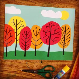 Overlapping Tree Collage. Students cut grass and ovals, glue and then draw tree lines on top with a marker. Great for 1st grade and up.