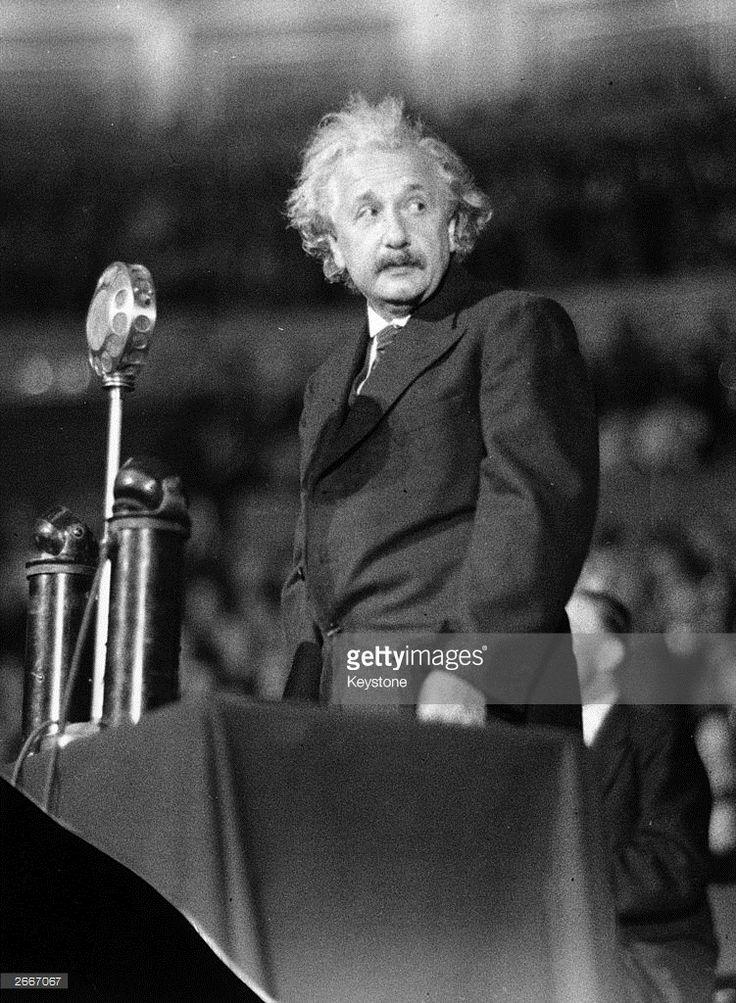 German-born American physicist Albert Einstein (1879 - 1955) speaking during…