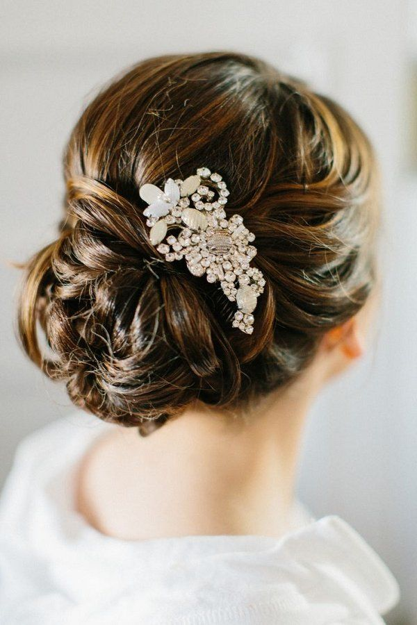 low wedding updo with hairpiece