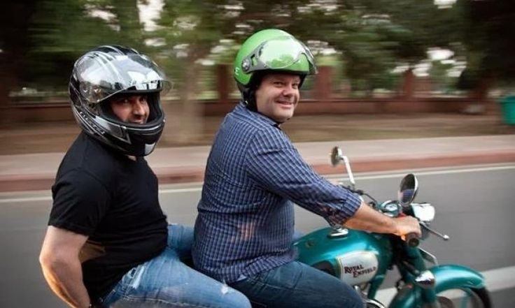 Gary Mehigan, on his favourite motorbike, the Royal Enfield, with his Masterchef Australia co-host and judge George Calombaris riding pillion in New Delhi. Since this picture was shot last year, Calombaris has lost 20 kilos!