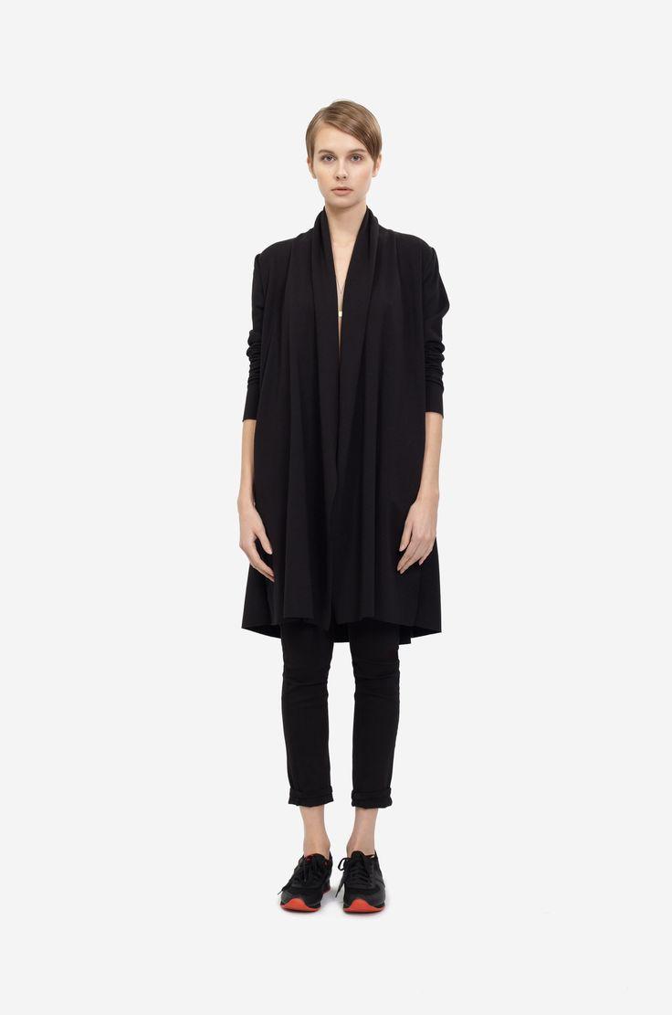 COTTON COAT Shorthaired model wearing a black cotton coat with black sneakers. Design: Lucie Kutálková / LEEDA