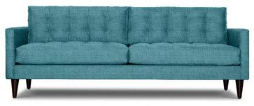 Love everything about this sofa: colour, cushions, arms, legs… Gorgeous! —JTL