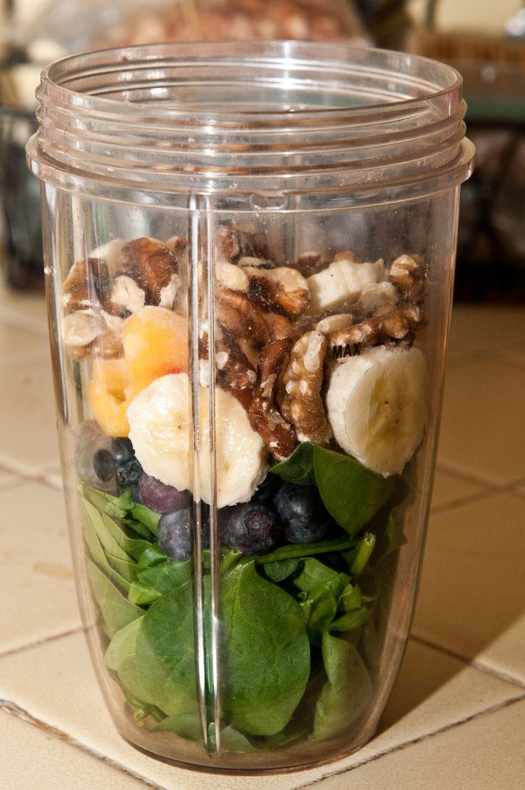 1 cup spinach, handful of blueberries, banana, 5 frozen peach slices, handful of walnuts. Add almond milk. Blend