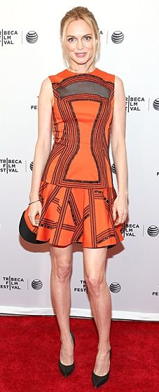Heather Graham wears a citrus-colored Robert Rodriguez dress to the Tribeca Film Festival