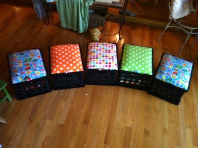 "Crate seats...use plastic crates purchased from your local walmart, plywood cut to fit the top, foam, fabric and a staple gun. What a cute idea for a child's room or a classroom reading corner. The ""seats"" can lift off so you can use the crates for storage."