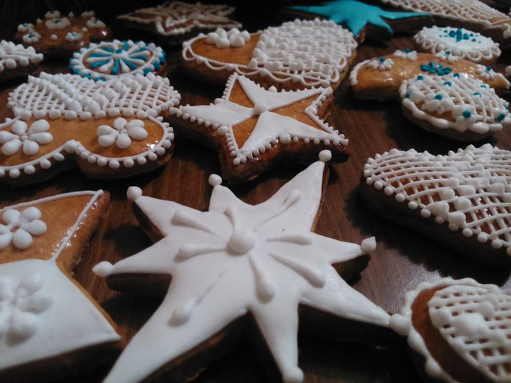 Traditional Central European Christmas honey cookies decorated by sugar glaze