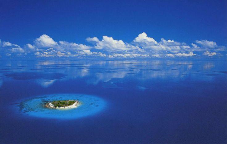 A secluded Island. Now that's a dream getaway.  Tahiti, French Polynesia - Beautiful Fotos of Tropical Islands | Tropical Paradise on Bora Bora, Moorea and Tahiti - OrangeSmile.com