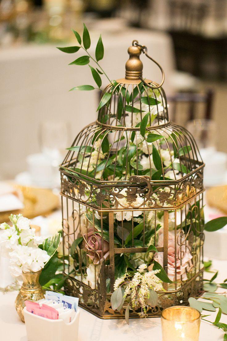 Gold Birdcage Centerpiece http://www.significanteventsoftexas.com