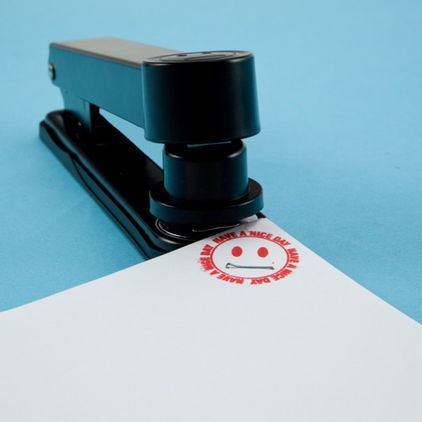 Stampler - Have a nice day face stamp and stapler in one.