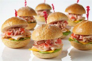 Mini Club Sandwiches — Celebrations at Home....  1 tomato, chopped  4 slices bacon, cooked & crumbled  1/4 cup mayonnaise  12 small dinner rolls, split  3 slices cheddar cheese, cut into 4 pieces each  1 (9 oz)package thin sliced turkey breast meat  6 lettuce leaves, torn in half  Combine tomato, bacon, and mayonnaise. Layer ingredients on bottom half of roll, top with tomato mixture, and replace top of roll.