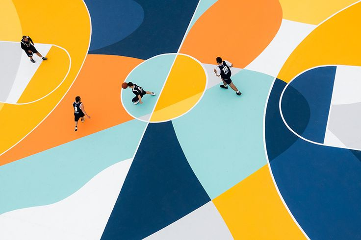 curved lines and shapes create a striking visual rhythm that highlights the movement within the space, amplifying the action and leaving a visual trace of each hard-fought match.