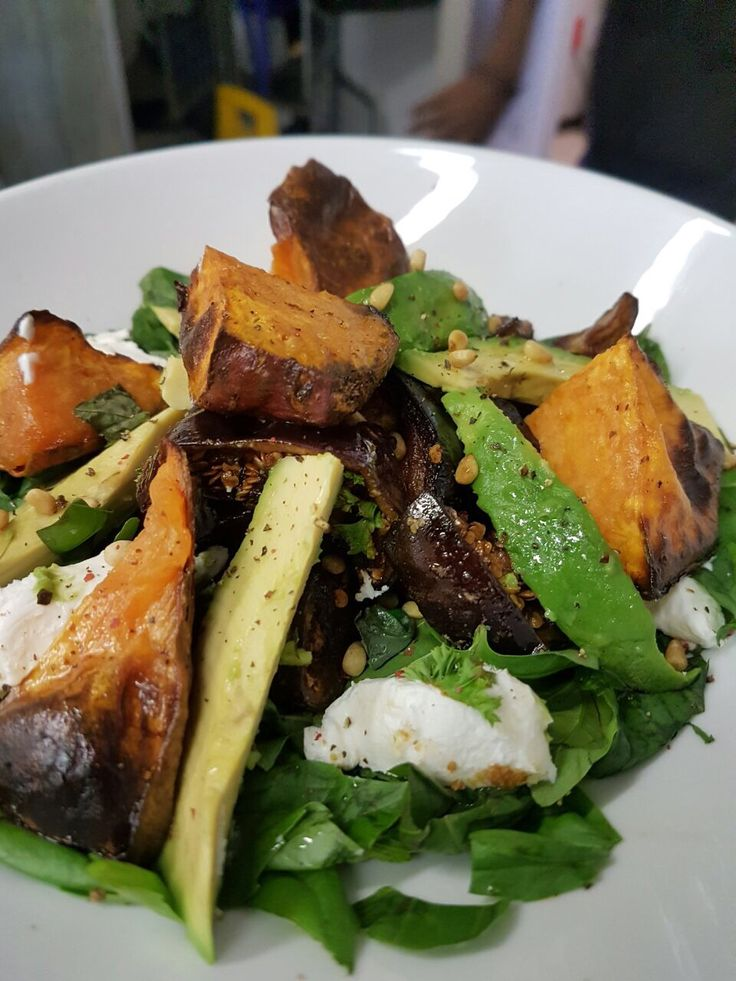 Freckle Face Salad Crispy brinjals, sweet potato & avo with goat's milk cheese & roasted pinenuts on a pillow of fresh sweet basil &  coarsely chopped mint