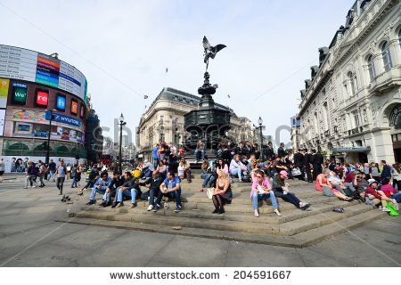 PICCADILLY CIRCUS London June 06, 2014: People enjoying the sun at Piccadilly  Circus London