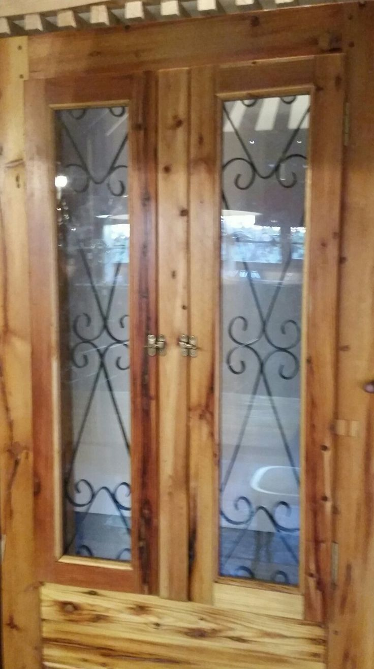Spanish burglar bar door with opening shutters.