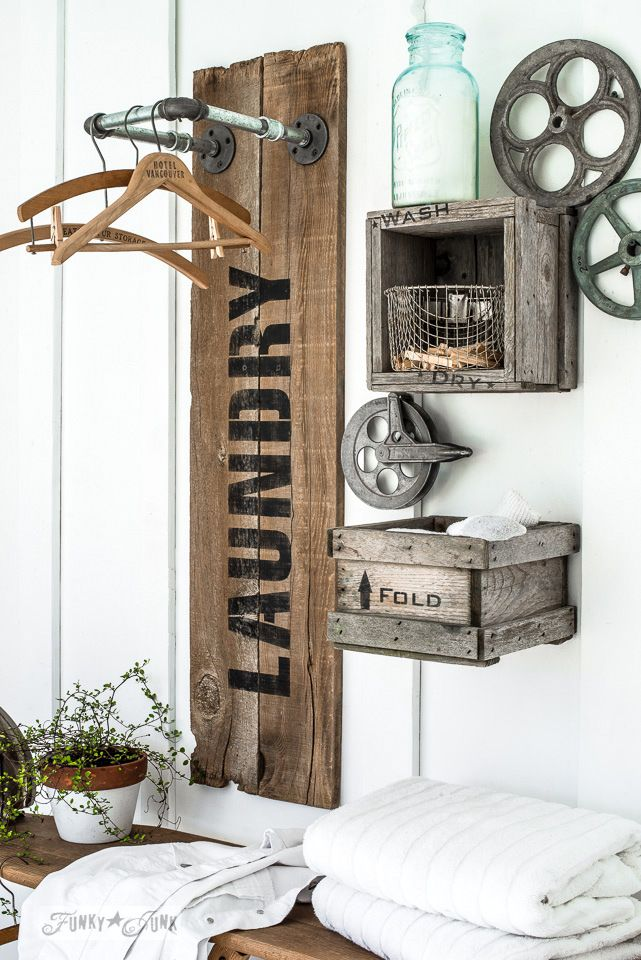 Creating an industrial farmhouse reclaimed wood and pipe LAUNDRY sign hanging station with crate shelves, with Funky Junk's Old Sign Stencils and Fusion Mineral Paint |  funkyjunkinteriors.netfunkyjunkinterior...