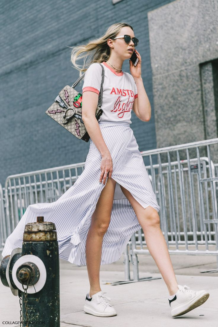 Stan Smiths with a tee, striped skirt, and Gucci bag.