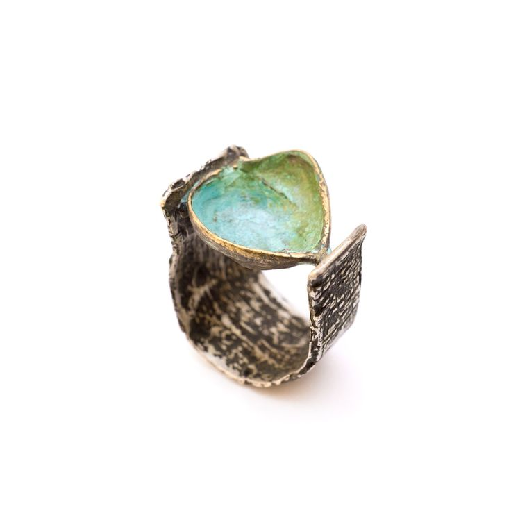 SilverBronze Dwarf Pomegranate Bark Ring Silver Ring made from tree bark that carries a bronze dwarf pomegranate cut in half.