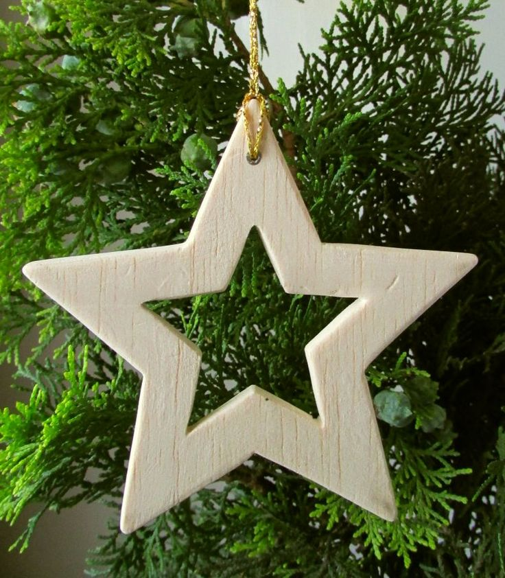 I cut a five-pointed star from balsa wood to make this easy Christmas tree decoration.