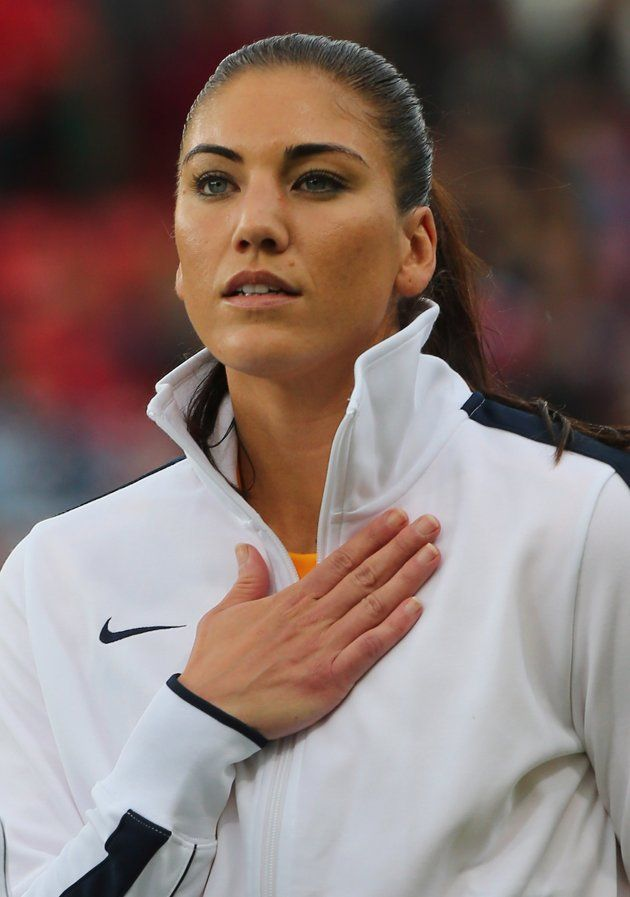 MANCHESTER, ENGLAND - JULY 31: Hope Solo of USA looks on during the national anthem during the Women's Football first round Group G match between the United States and DPR Korea on Day 4 of the London 2012 Olympic Games at Old Trafford on July 31, 2012 in Manchester, England.