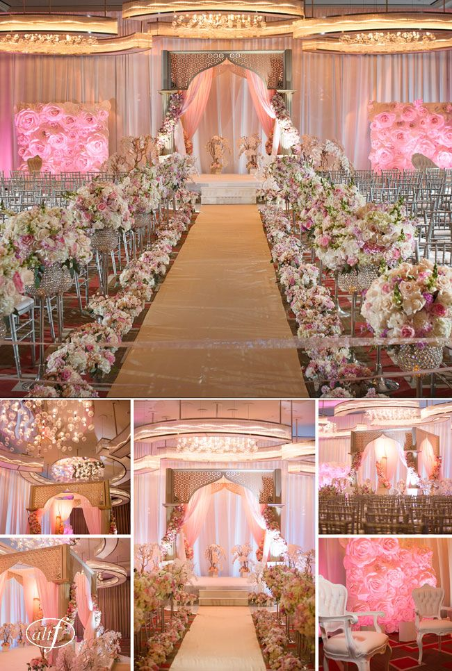 Immaculate, lush and modern pink and gold Mandarin Oriental Las Vegas wedding aisle. Floral design by Destinations By Design, flower walls by the Paper Flower Girls, Photo: Altf