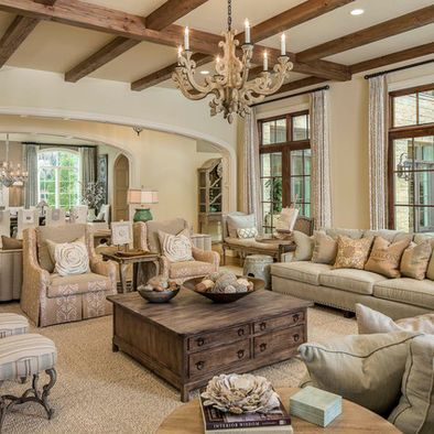 Love the wooden beams on ceiling and the coffee table.. Everything else is way too elegant for a livable living room.