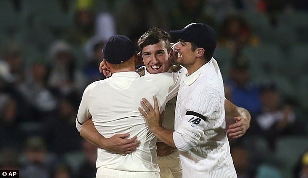 Overton looked thrilled as he was congratulated by Bairstow and Alastair Cook (right)