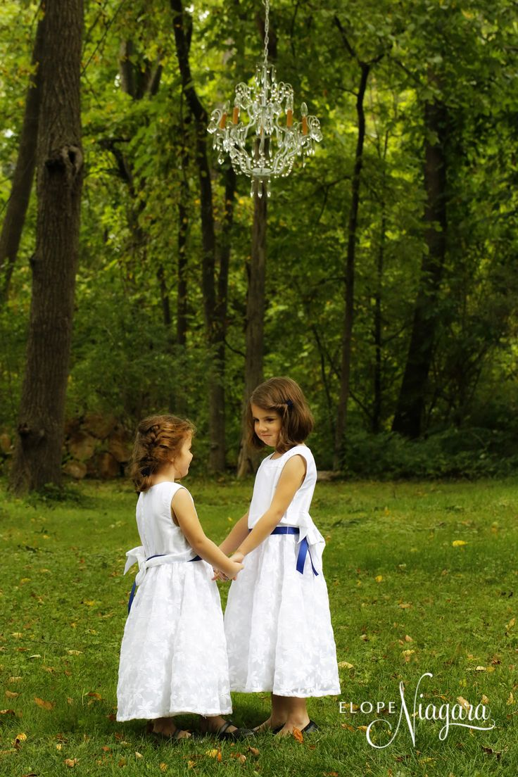Cute Flower Girls Under The Antique Chandelier At Little Log Wedding Chapel In Niagara Falls