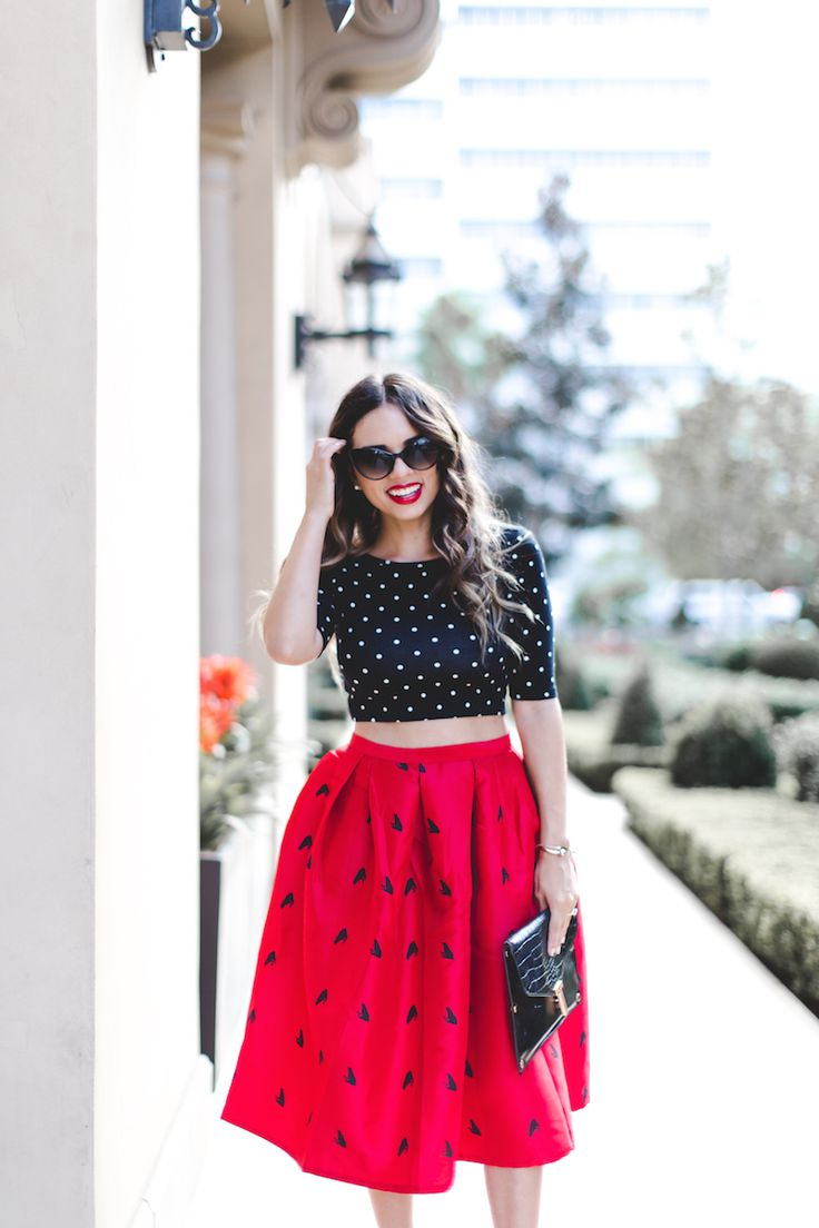 Crop tops and midis make the perfect pair.