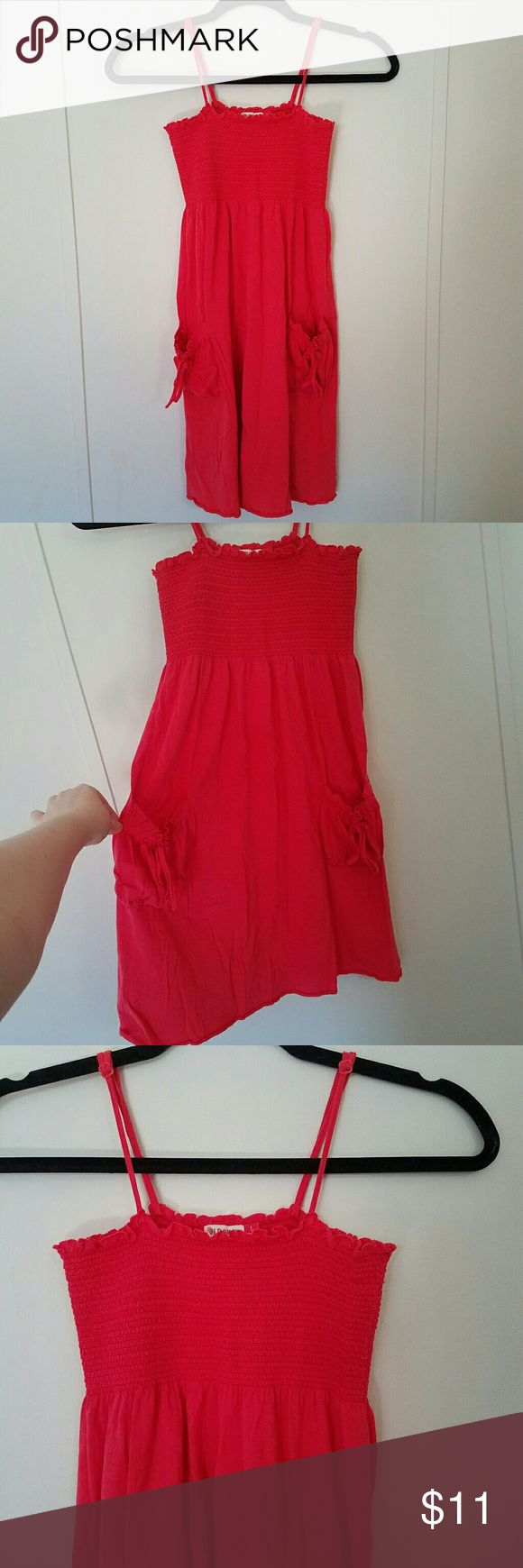 Old Navy Coral Sundress Old Navy coral sundress with adjustable straps and pockets.  Stretchy smocked bust.  2 side pockets with ties.  Only worn a few times!  Excellent condition!  Size Large. Old Navy Dresses Mini
