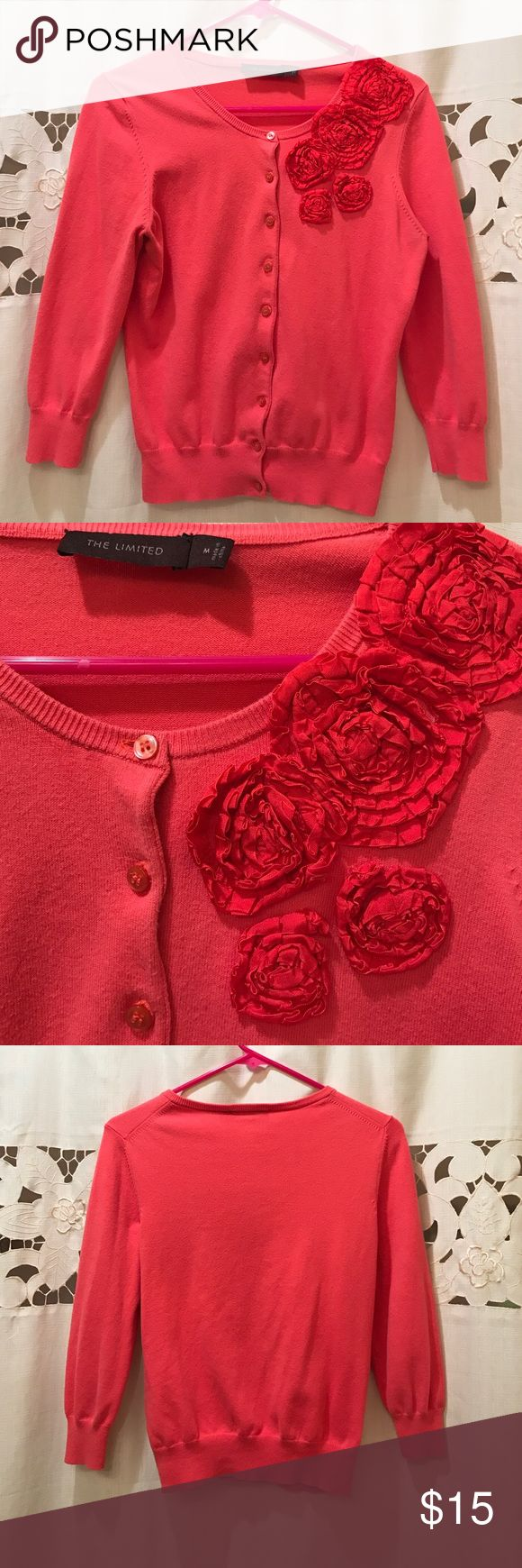 Button down coral cardigan with flower detail The Limited medium button down cardigan. Coral cardigan with red flower detail near shoulder. The Limited Sweaters Cardigans
