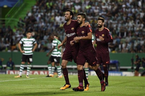 Sergio Busquets and Luis Suarez of FC Barcelona celebrates after scores the first goal during the UEFA Champions League group D match between Sporting CP and FC Barcelona at Estadio Jose Alvalade on September 27, 2017 in Lisbon, Portugal.