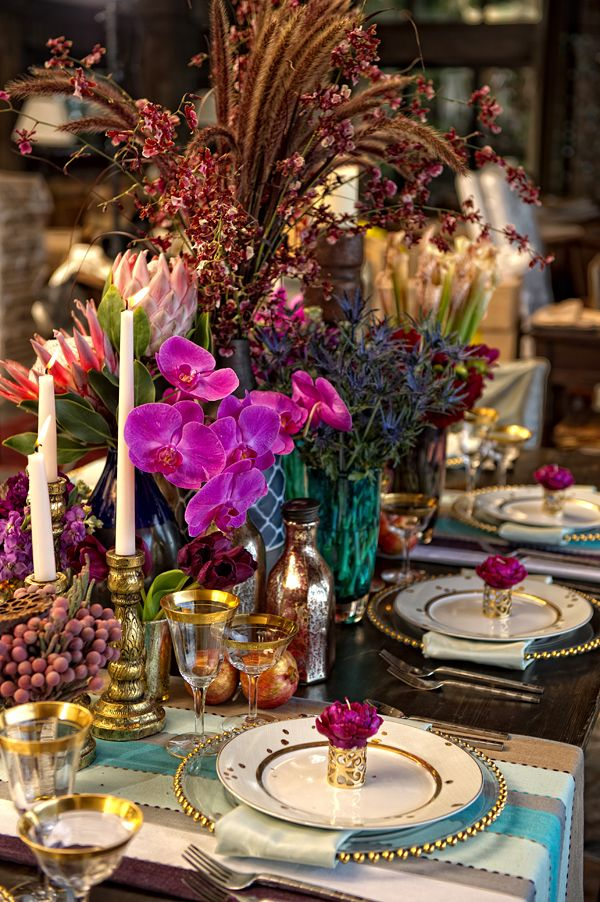 table with beautiful crystal and gold stemware and fuchsia phalaenopsis orchids