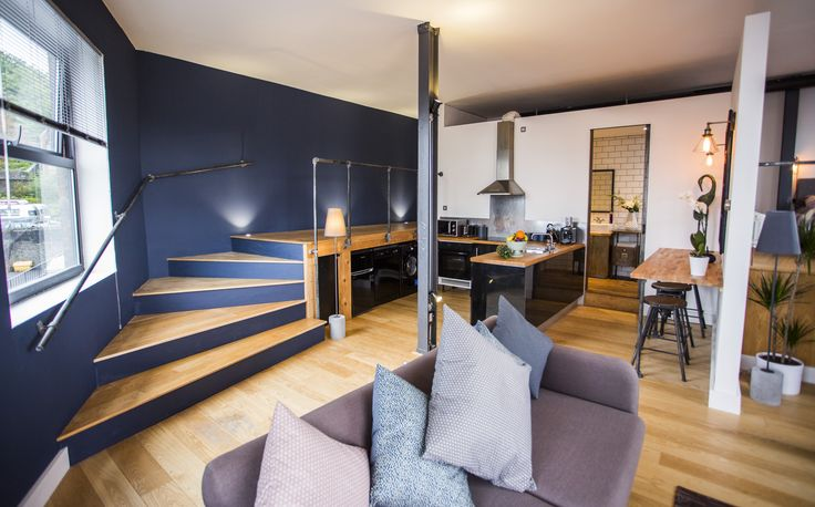 Custom built entrance with curved stairs at the river loft  https://www.airbnb.co.uk/rooms/6347144