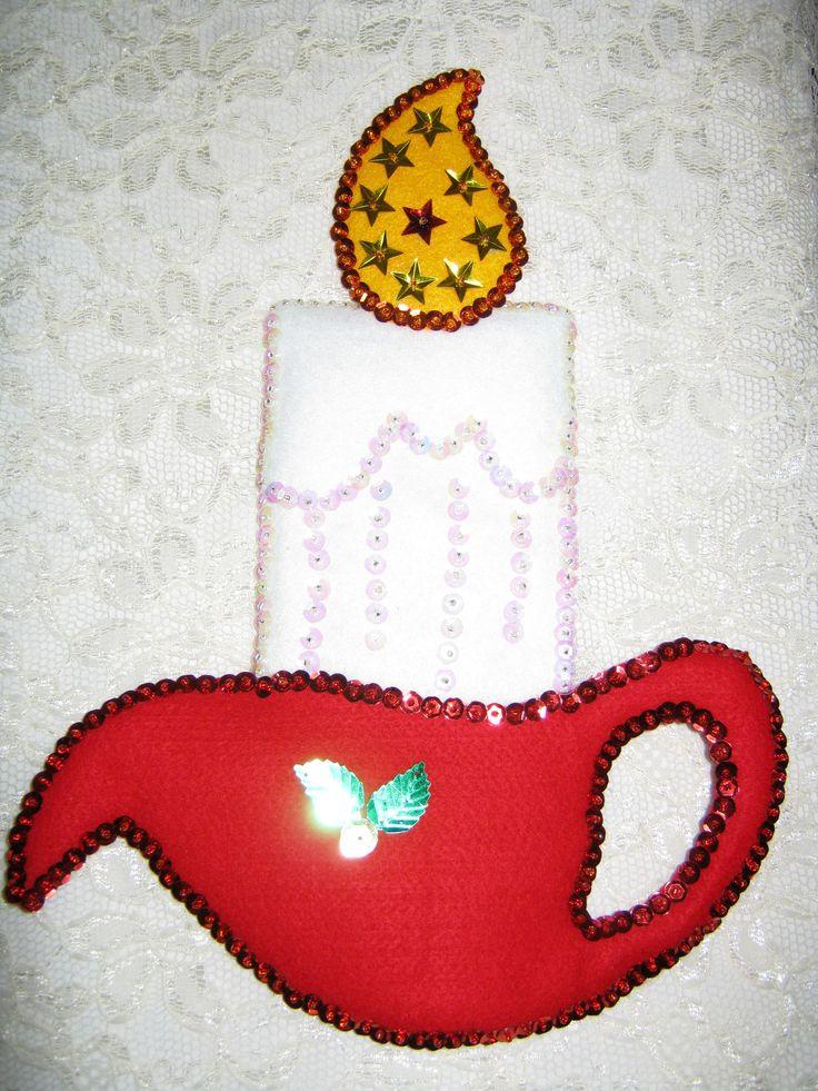 Vela navideña colgante hecha en paño lency y lentejuelas...