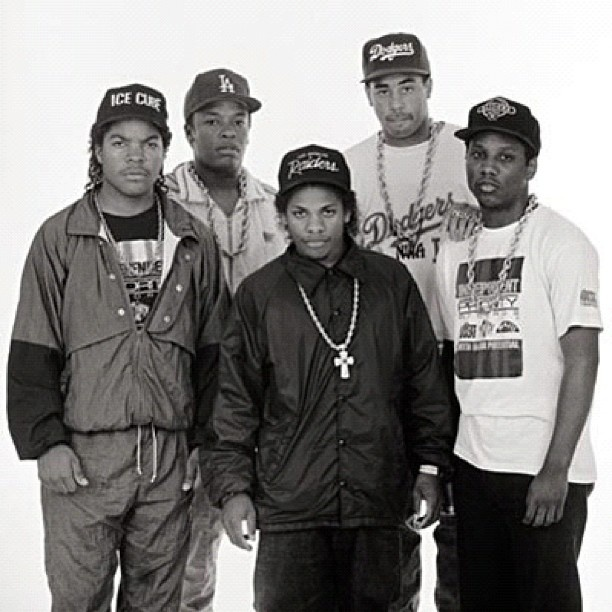 N.W.A (Niggaz Wit Attitudes), American former rap group comprised of Arabian Prince (not shown), DJ Yella, Dr. Dre, Eazy-E, Ice Cube, & MC Ren, one of the seminal acts of the Gangsta rap music. Considered controversial due to their explicit lyrics, they were banned from many US radio stations. Despite this, they have sold over 10M units. Their album Straight Outta Compton marked the beginning of the new gangsta rap era as the production & social commentary in their lyrics were revolutionary…