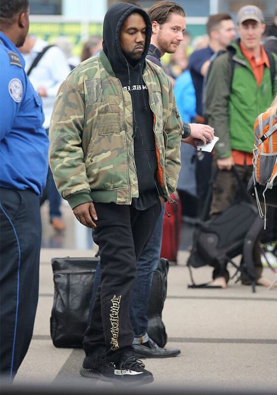 7e35a0af7 Kanye is wearing a Raf Simons Bomber Jacket