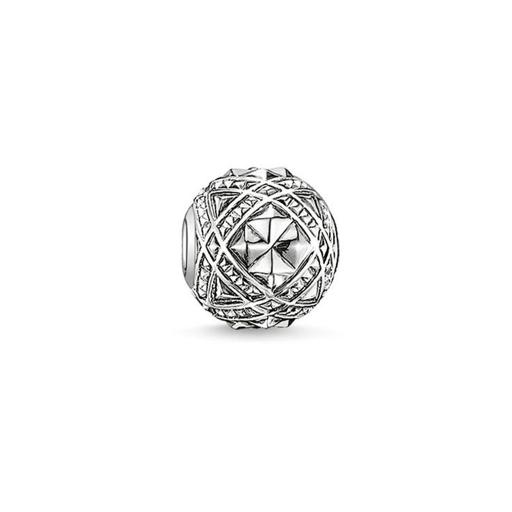 THOMAS SABO Karma Bead from the Sterling Silver Collection. Studs - 925 Sterling silver, blackened Size: ca. 1,1 cm In the Art Deco style, the expressive rivets line up around the graphic STUDS KARMA BEAD, lending this bead crafted from blackened 925 Sterling silver a particularly charming feel.